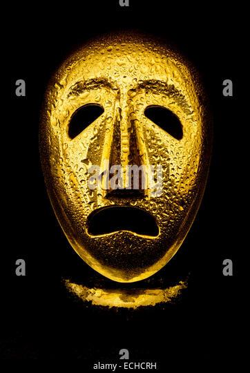 Melpomene the Muse of tragedy golden mask. - Stock Image