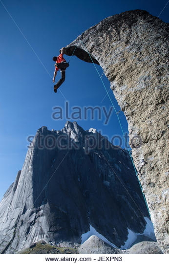Climber reaches the top of rock at Cirque of the Unclimbables. - Stock Image