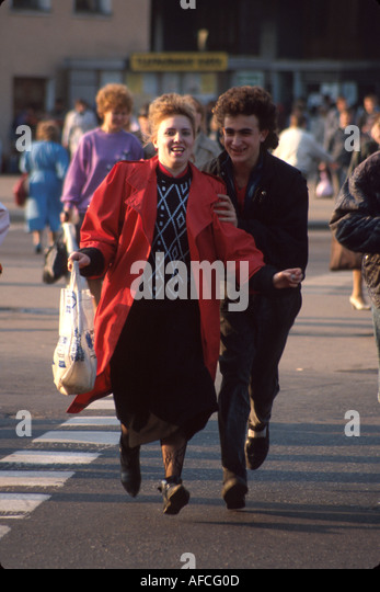Russia former Soviet Union St. Petersburg residents cross busy city street - Stock Image