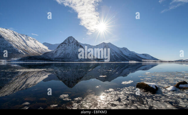 Norway, Hognfjord, Sunshine over mountains - Stock Image