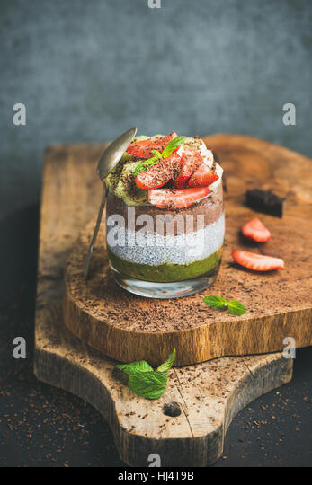 Matcha, almond milk, cocoa chia seed pudding, fruits, mint, chocolate - Stock Image