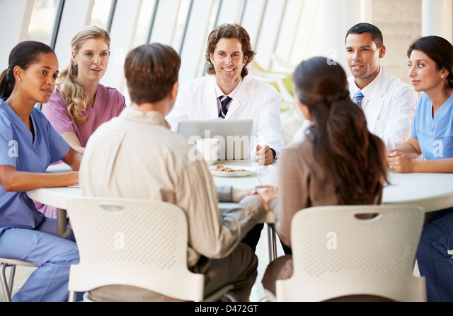 Medical Team Discussing Treatment Options With Patients - Stock Image