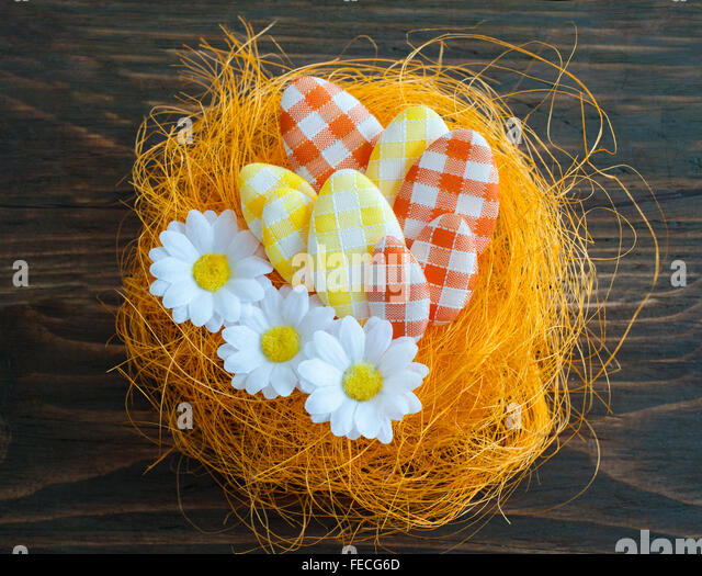 Easter eggs in an artificial nest - Stock Image