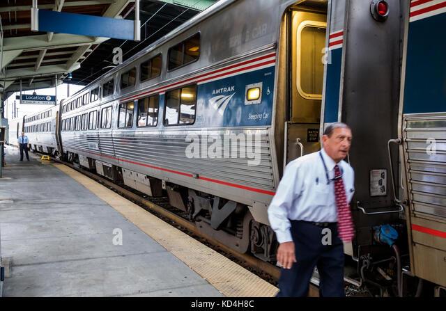 Washington DC District of Columbia Union Station railroad train Amtrak sleeping car conductor man platform - Stock Image