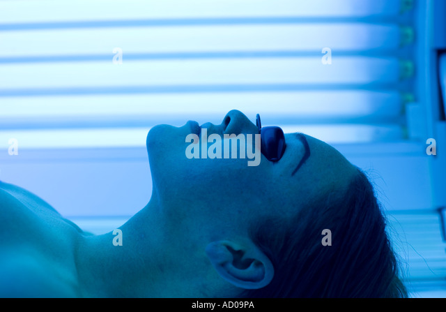 A woman lying on a sunbed in Birmingham UK - Stock Image