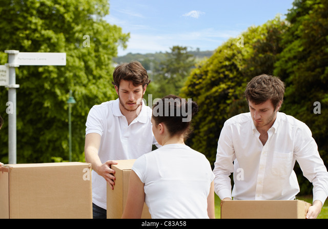 People stacking cardboard boxes - Stock Image
