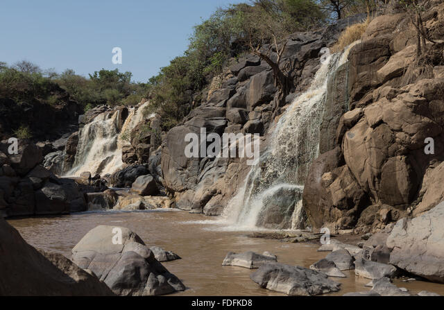 A waterfall into a rocky gorge in the Awash National Park, Ethiopia - Stock Image