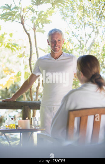Couple relaxing together on balcony - Stock Image