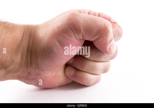 A male mans hand with a clenched fist and power - Stock Image