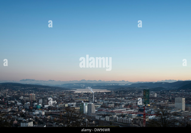 Cityscape, Lake Zurich at the rear, Swiss Alps on the horizon, Zurich, Switzerland - Stock Image