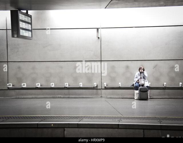 Lady waiting at Kings Cross St Pancras - Stock Image