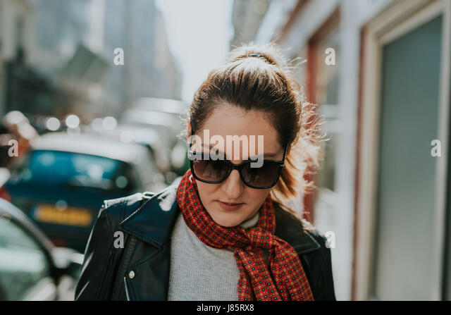 French woman walking on the streets of Paris - Stock Image