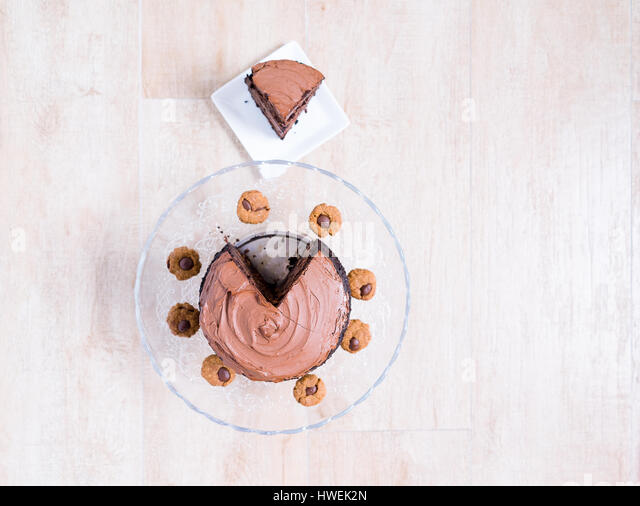 Chocolate Cake with Chocolate Frosting on Glass Cake Stand - Stock Image
