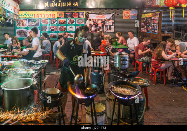 Chinatown, night market, cook with woks,  Restaurant, street food, Bangkok, Thailand - Stock Image