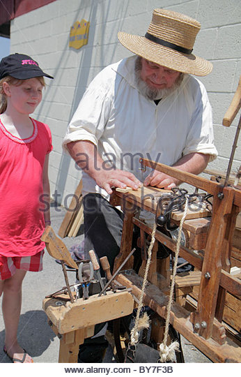 Pennsylvania Kutztown Kutztown Folk Festival Pennsylvania Dutch folklife arts and crafts vendor artisan wood carving - Stock Image
