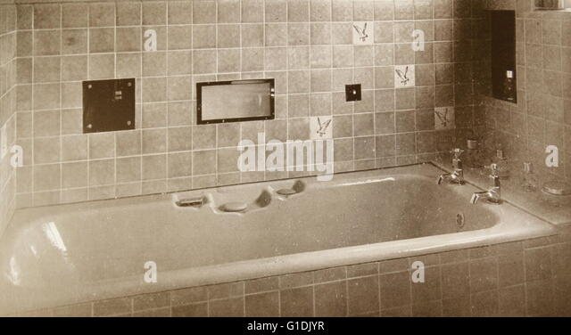1940's tiled bathroom with bath; British - Stock Image