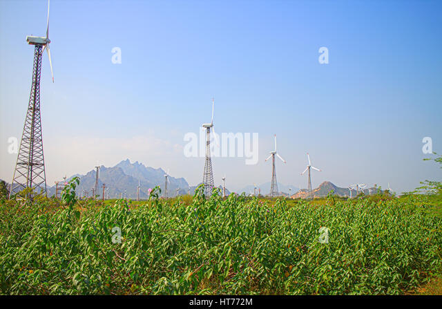 Alternative energy sources 8. Wind farm in Indian province of Kerala. Many wind-powered generators stand opposite - Stock Image