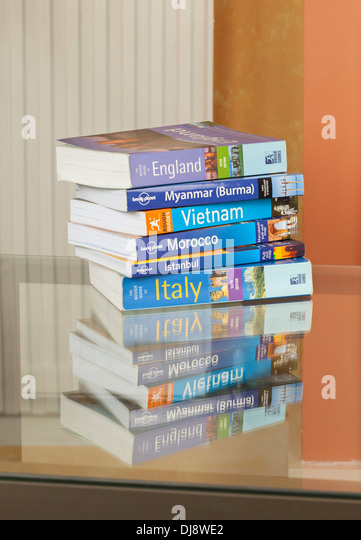 Travel books on a table - Stock-Bilder