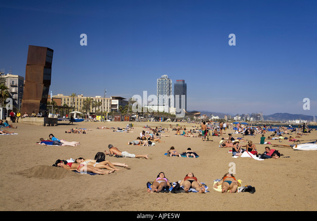 Spain Barcelona beach Platja de la Barceloneta people Sculpture by Rebecca Horn girls sunbathing - Stock Image