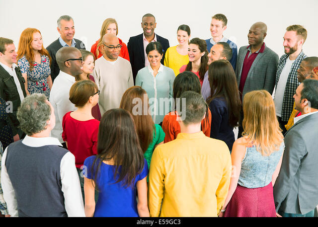 Diverse crowd meeting in circle - Stock Image