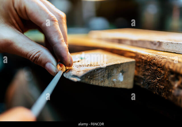 Jeweler working on ring in his workshop - Stock Image
