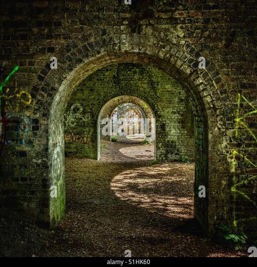 Arches & Graffiti - Stock Image