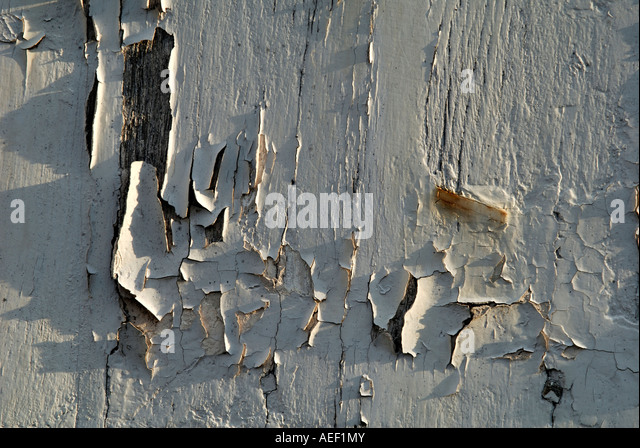 Peeling paintwork on window shutters, France. - Stock Image