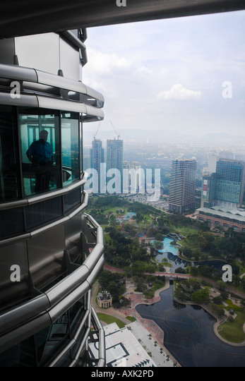 business working new city skyscraper building windowns office lines angles round groud down modern men looking sky - Stock Image