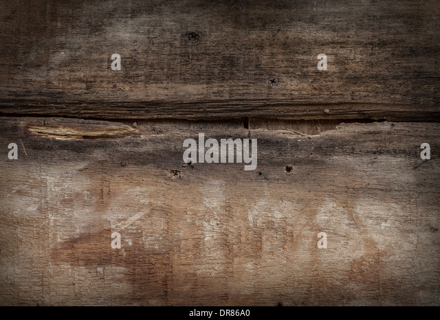 Closeup view of a grungy cracking textural background. - Stock Image