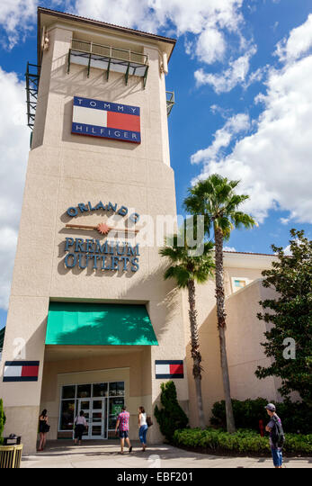 Orlando Florida Premium Outlets shopping Tommy Hilfiger designer clothing outside entrance - Stock Image