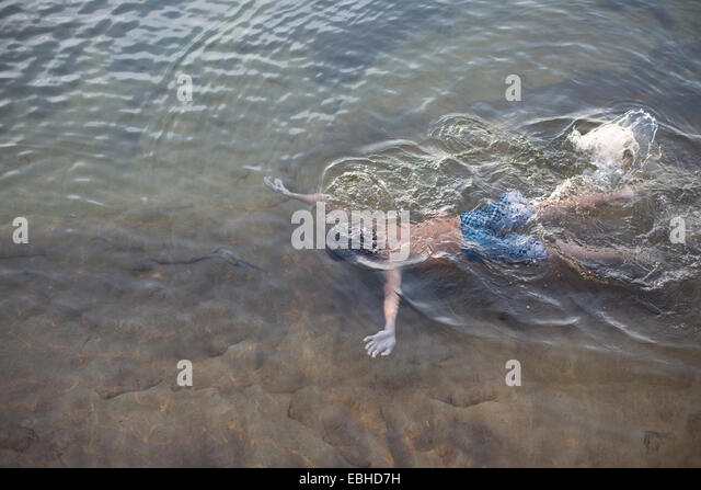 High angle view of teenage boy swimming underwater in Lake Superior, Au Train, Michigan, USA - Stock Image