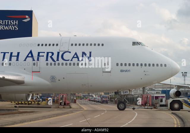 Boeing 747 444 South African Airways ZS SAK 005 Ibhayi crossing Eastchurch Road at London Heathrow Airport UK - Stock Image