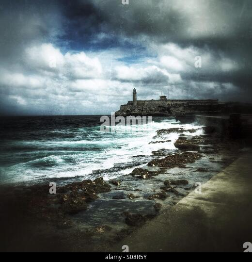 View of the lighthouse from the Malecon on a stormy day. Havana, Cuba. - Stock Image