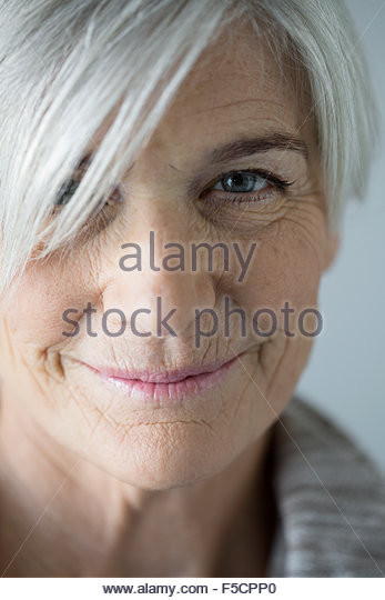Close up portrait smiling senior woman - Stock Image