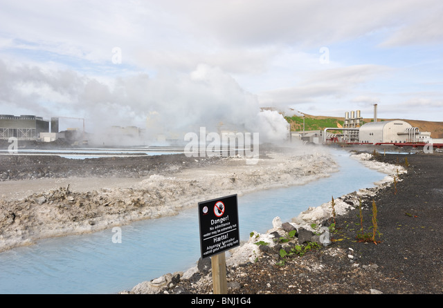 Svartsengi geothermal power plant near Grindavik, South Iceland. Black warning sign because of hot water - Stock Image