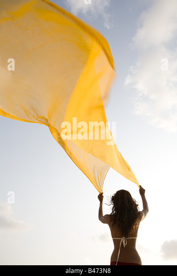 Woman with yellow cloth - Stock-Bilder