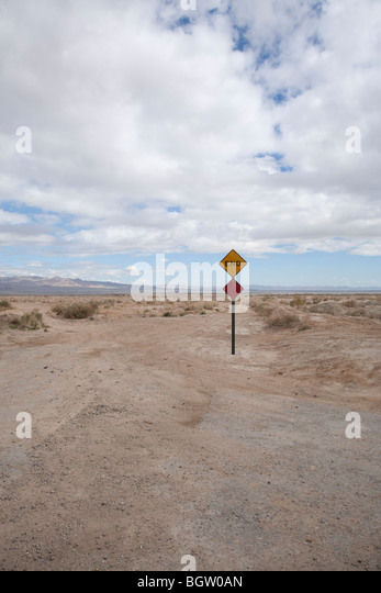 Humorous sign that says 'End' in the middle of the Mohave Desert outside the town of Mecca, California. - Stock Image