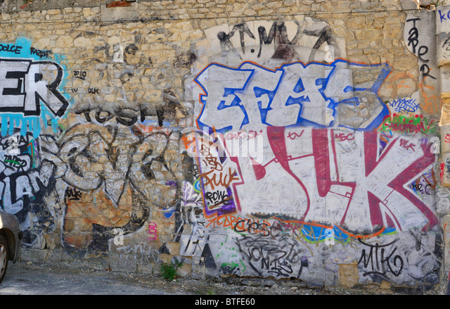 Old stone building with its wall artistically painted with graffiti is located in the resort town of La Rochelle, - Stock-Bilder
