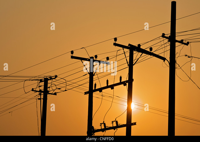 Telegraph  poles and telegraph wires at sunrise - Stock-Bilder
