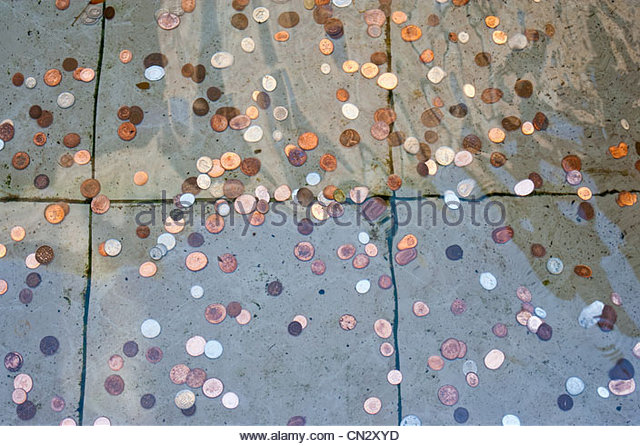 Coins in water - Stock Image