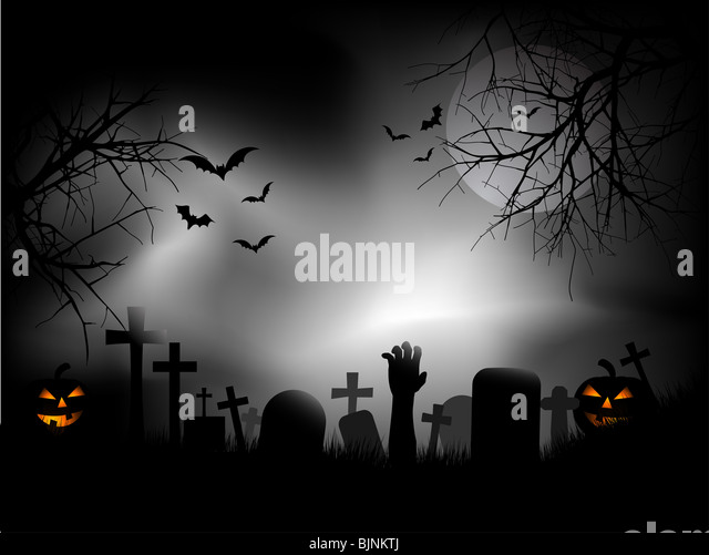 Spooky graveyard with zombie hand coming out of the ground - Stock Image