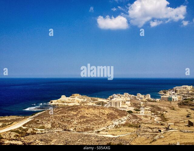 Blue sea and white clouds - Stock Image