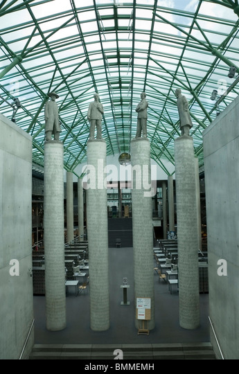 Sculptures columns of famous Poles pioneers in logic in the foyer, entrance to the Warsaw University Library, Poland, - Stock Image
