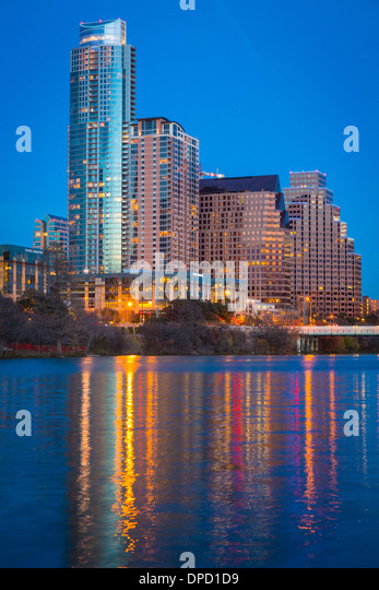 Austin skyline and the Colorado River at night - Stock Image