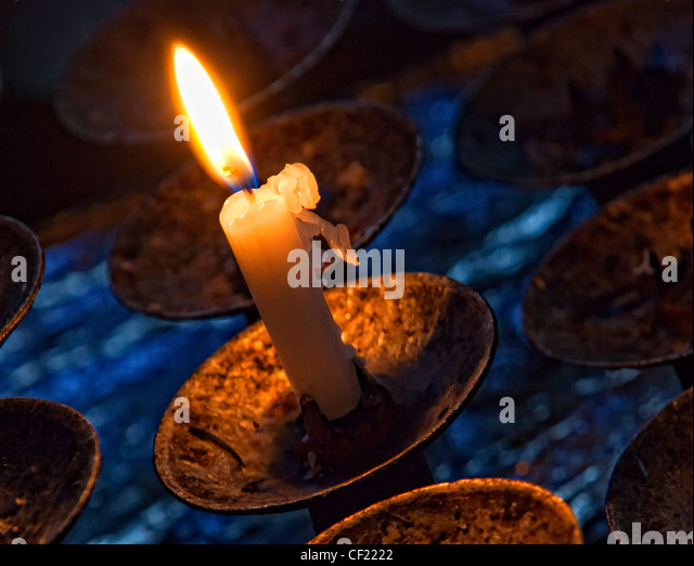 Burning candle in St Mary's Church, Great Budworth, Near Northwich and Antrobus , Cheshire England, United Kingdom - Stock Image