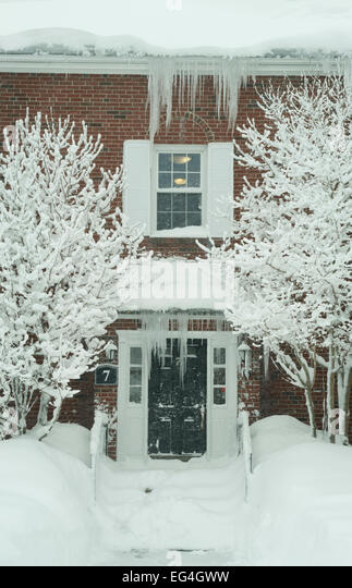 Lexington, MA, USA. 15th Feb, 2015.  Apartment Building entrance covered in ice and snow after another winter snow - Stock Image