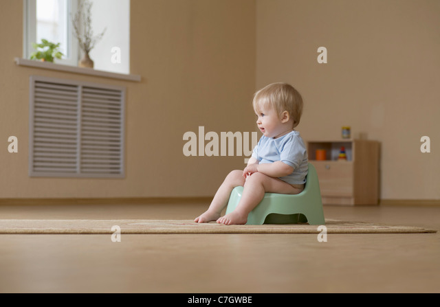 Girl training potty stock photos girl training potty for Toddler sitting chair