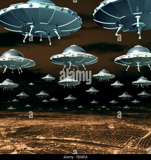 Alien invasion concept as a menacing group of invading flying saucers and spaceships over a city as science fiction - Stock-Bilder