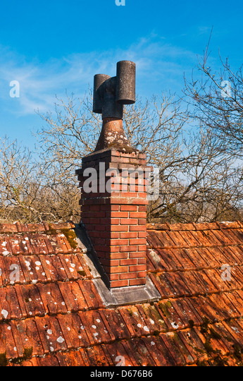Old brick chimney pot - France. - Stock Image
