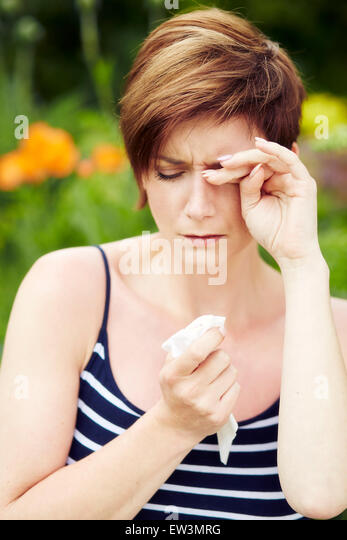 Girl with hayfever - Stock Image